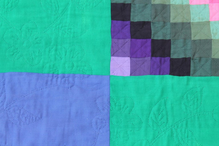 This fine Amish quilt is from Lancaster County, Pennsylvania. It is mostly wool and cotton made trip around the world or sunshine quilt. It has initial on the reverse side or back. The backing is made of grey cotton shambre.