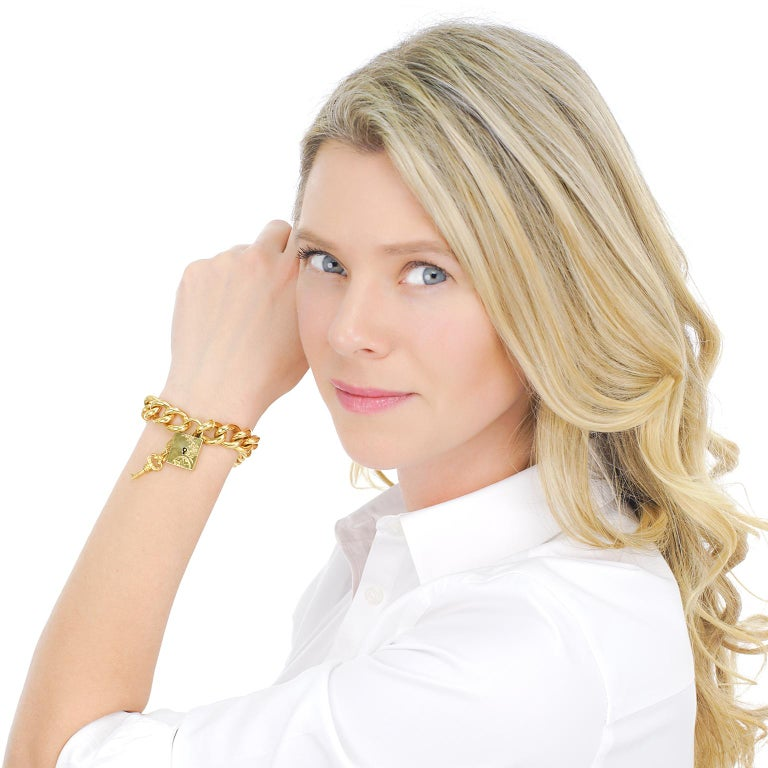 Circa 1890s, 14k, American.  This chic lock and key bracelet is the perfect all-gold accessory. The look is Victorian whimsy at its stylish American best. Finely fabricated in 14k yellow gold, this piece, with its working lock and key, is in