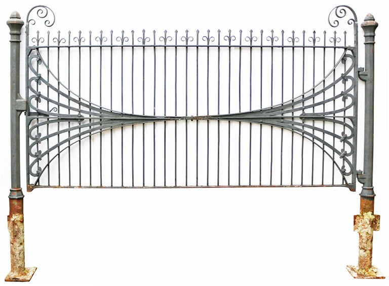 About  This impressive wrought iron, blacksmith made gate, comes with cast iron posts. English. Removed from Runnymede Park, Egham.   Condition report:  This gate and posts are in good structural condition.  The old paint is flaking and