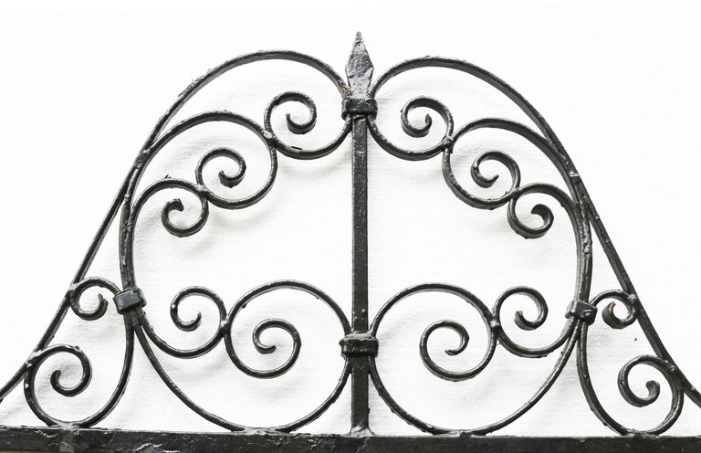 About  A blacksmith made wrought iron garden or side gate.  Condition Report  This gate is in great condition for its age and use. There is a working latch and part of the original hinge present.  Style  Victorian  Date of