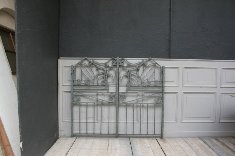Antique wrought-iron garden gate from an old patrician villa in Switzerland. The gate was sandblasted and galvanized some years ago to protect it against rust. It consists of 2 wings, of which the left side can be classically determined with a lever
