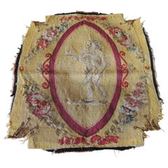 Antique Yellow and Red Woven Aubusson Tapestry Fragment Depicting a Cherub