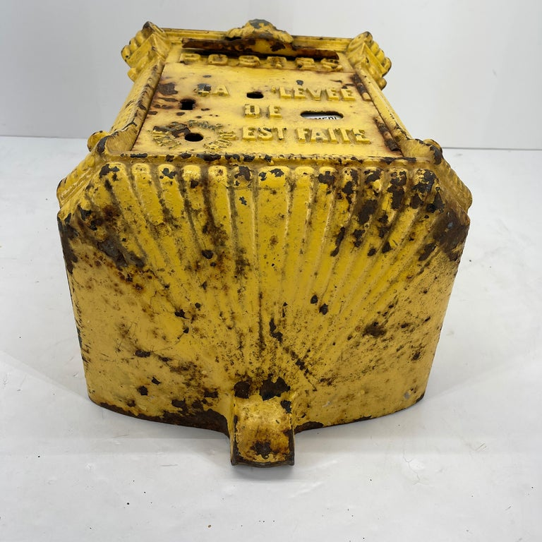 """Old plank antique yellow cast iron French mailbox. Dated early 1900s-1930s. Cast iron and steel was used in the manufacturing process of mail boxes, beginning circa 1900 in France. They became known as """"Mougeottes"""" after their founder. This"""