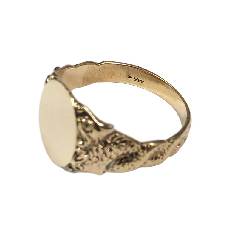 Circa 1910 14K Yellow Gold Signet Ring, the top measures 9/16 X 7/16 inch, the sides of the ring are heavy chased intertwined serpents with a double head at the top. Finger size 11.