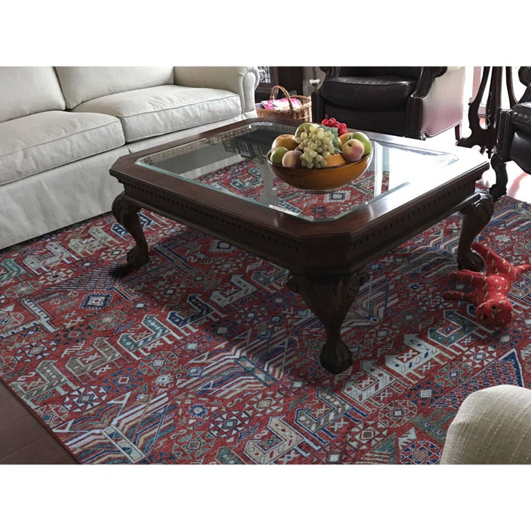 This is a truly genuine one-of-a-kind antiqued Caucasian Akstafa design hand knotted pure wool rug. It has been knotted for months and months in the centuries-old Persian weaving craftsmanship techniques by expert artisans. Measures: 8'1