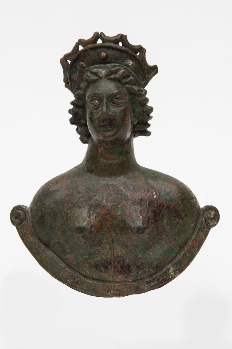 Large bust weight of Venus with silver inlaid eyes and celestial diadem,Roman culture,Germany,2nd-3rd century AD. The goddess is depicted nude, slightly gazing to her right with detailed silver inlaid eyes and firmly expressed lips. Her hair is