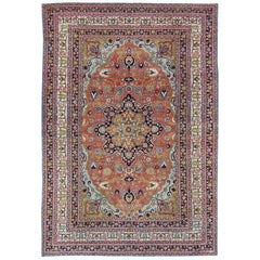 Antique Tabriz Rug with Circular, Script-Style Medallion and Orange Background