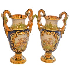 Antoine Montagnon Rouen Vases Hand Painted Cherub Scene and Dragon Handles Pair