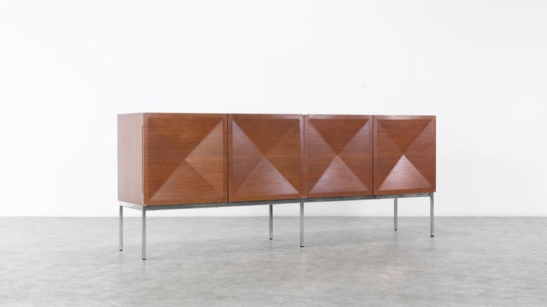 Sideboard with diamond shaped doors (Pointe de Diamant) designed by Antoine Philippon and Jacqueline Lecoq.  Manufactured by Behr, Germany in 1962.  (Original EWB, Behr stamp on the backside, see photos)  Sideboard with four white diamond