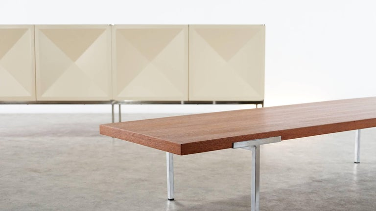 Very rare sofa table designed by Antoine Philippon and Jacqueline Lecoq. The tabletop is made of walnut and is hold by four chrome-plated metal bases.  Manufactured by Laauser. The walnut top has been completely restored by our wood-specialist,