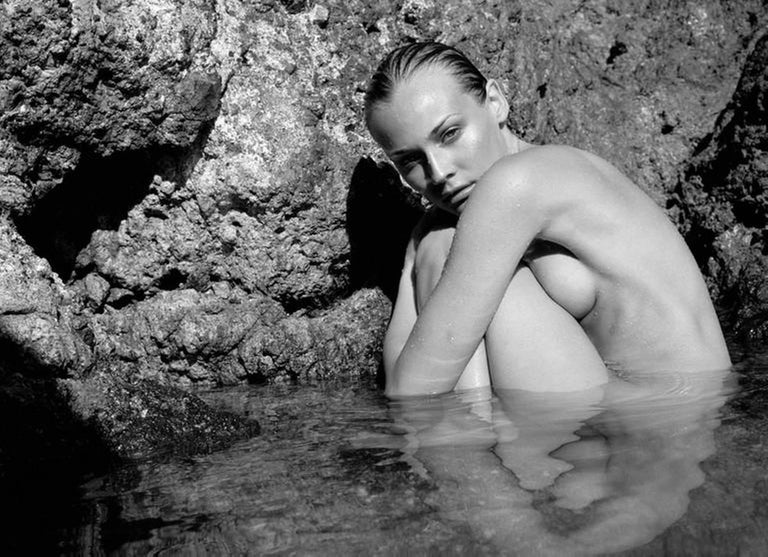 Antoine Verglas Black and White Photograph - Diane Kruger naked in the sea in front of a cliff
