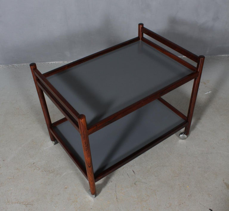 Anton Kildeberg cart in rosewood and grey laminate.  Mounted on wheels.  Made in the 1960s.