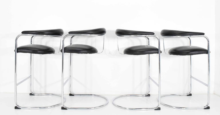 We have eight of these stools available. We also have another two in white under a separate listing. They are designed by Anton Lorenz for Thonet. Chairs are in beautiful condition with shiny chrome frames and a black faux leather seat and back.