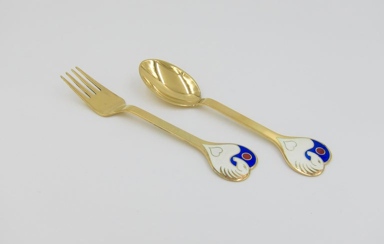 A Danish gilded sterling silver and enamel Christmas fork and spoon set from Anton Michelsen of Copenhagen, Denmark. Vibeke Alfelt (1934-1999) created this
