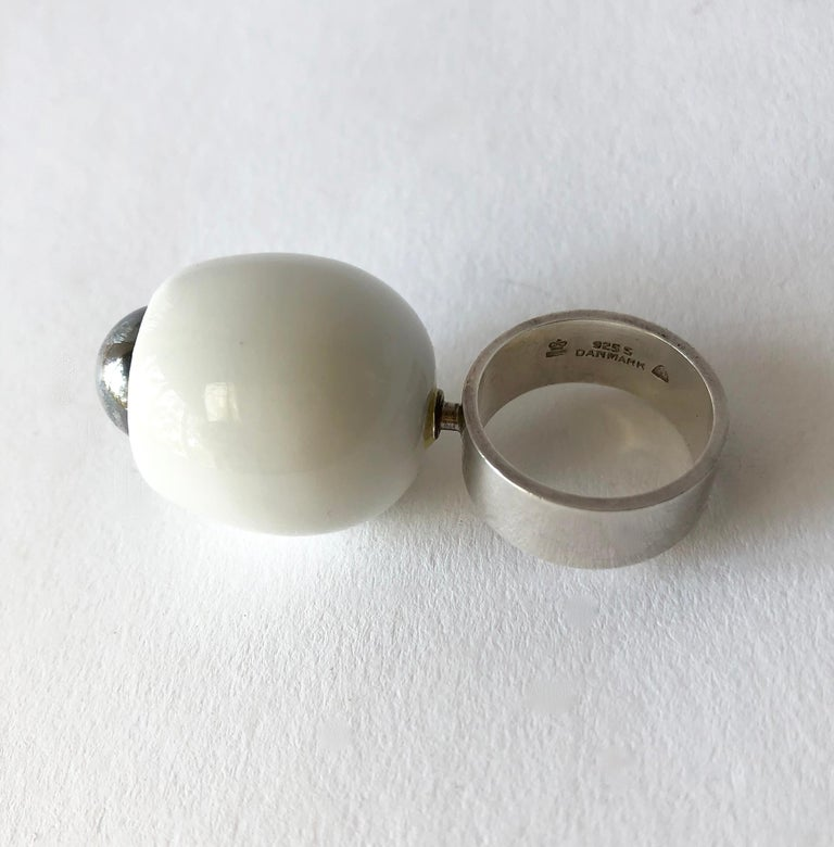 1960's Danish modernist Royal Bini ring created by Anton Michelsen for Royal Copenhagen of Denmark. Ring is a finger size 7 and is made up of a porcelain egg shaped cup and a large sterling silver ball centered within. Ring sits about 1 1/4