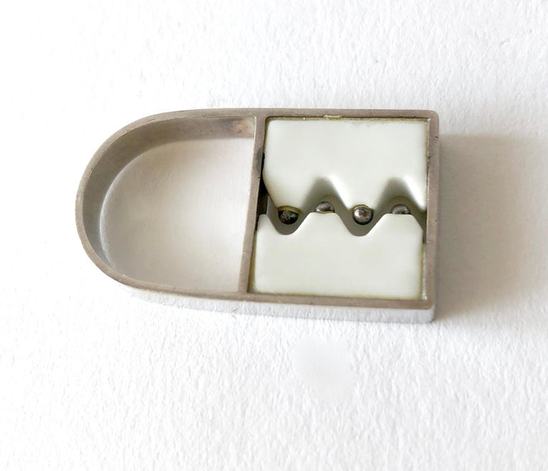 1960's Danish modernist Royal Bini ring created by Anton Michelsen for Royal Copenhagen of Denmark. Ring is a finger size 6 to 6.5 and is features a zig zag designed porcelain with silver ball accents, all within a silver frame. Ring sits about 5/8