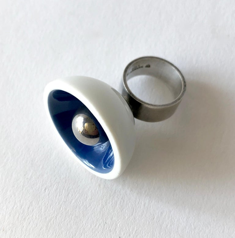1960's Danish modernist Royal Bini ring created by Anton Michelsen for Royal Copenhagen of Denmark. Ring is a finger size 5.75 to 6 and made up of a porcelain cup with royal blue interior accent and a large ball of sterling silver centered within.