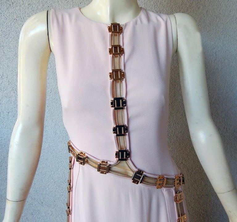 Antonio Berardi pale pink bias cut asymmetric gown with rose gold enhancement hardware.  Drawstrings are attached as pulleys to cinch parts of the dress as needed and to allow flashes of flesh to peek out. Dress also can be worn as shown on