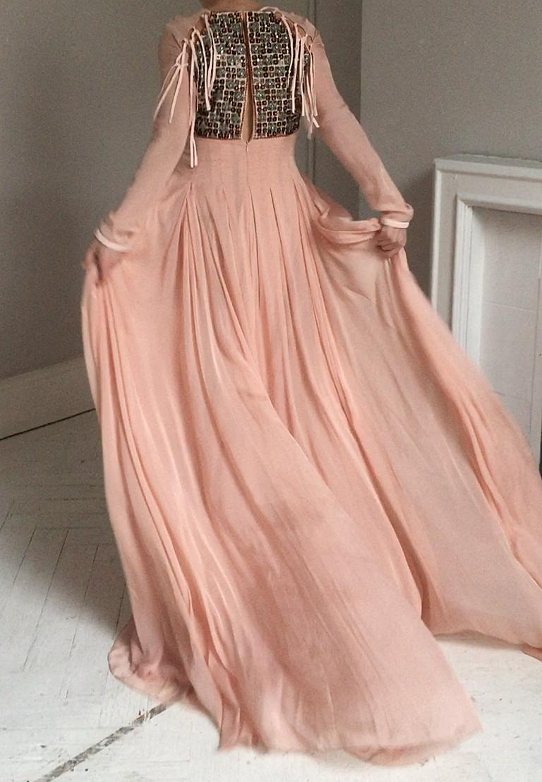 Dreamy ethereal beaded gown by Antonio Berardi.  A wonderful wearable exquisite work of wearable art.   Fashioned of pale pink silk chiffon with skirt of multiple layers of chiffon.   Hand beaded bodice of semi precious stones beautifully arranged