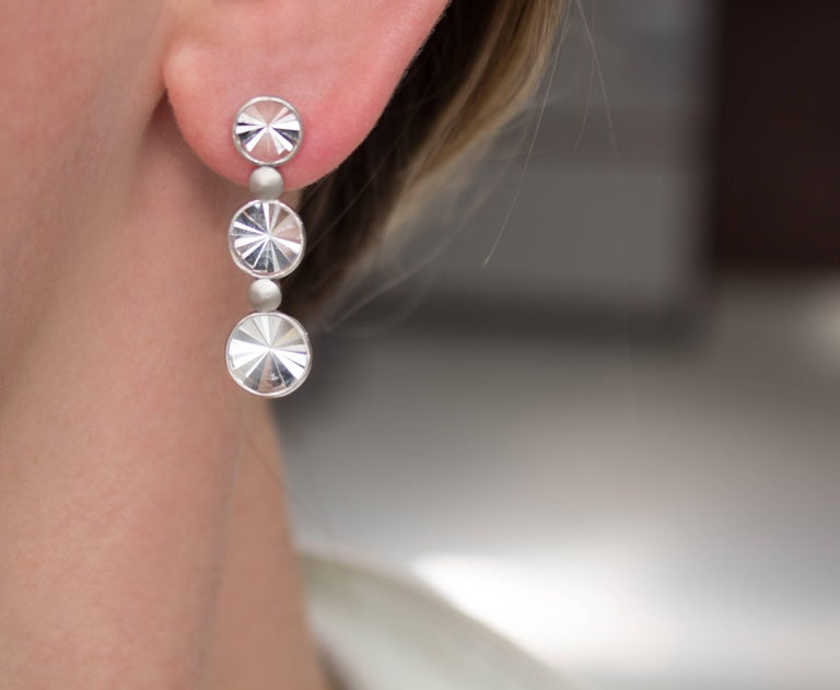 One of a Kind Waterfall Earrings handcrafted in Rio de Janeiro by jewelry maker Antonio Bernardo featuring six signature prism-cut rock crystal elements set in polished 18k white gold and accented by matte-finished 18k white gold disc elements.