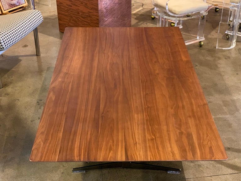 A stunning walnut cocktail coffee table designed by Antonio Citterio for Flexform. It features metal supports and Lucite feet. Retains two Flexform made in Italy Labels. In good condition, with minor imperfections.