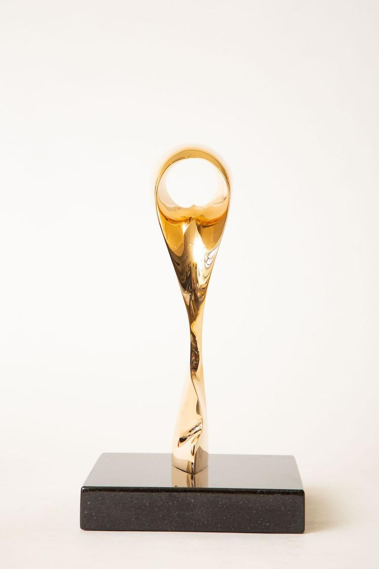 This wonderful Antonio Gediaga Kieff abstract bronze sculpture is a limited edition. It is signed Kieff 2/6. The bronze has all been polished and sits on a black granite base all original. This is a lyrical and elegant form by a well known and