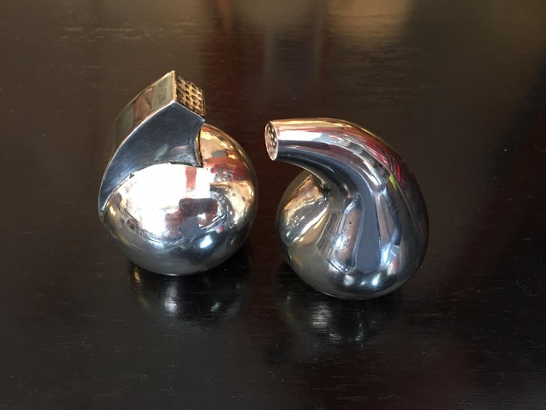 Sculptural salt and pepper by Noted Silversmith Antonio Pineda. Lovely forms, with hallmarks to underside.