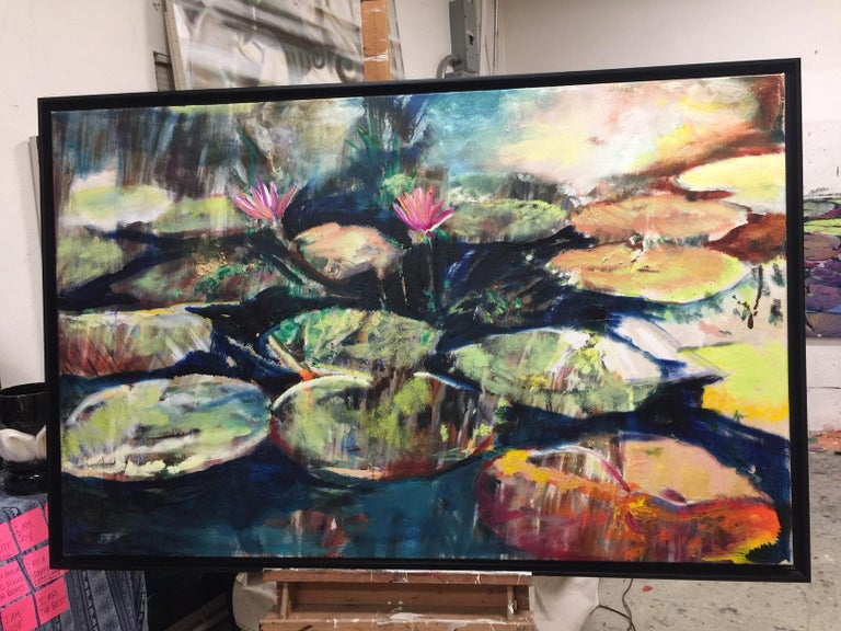 """Two Water Lilies 38 X 60 oil on canvas in black framed. detail photos shown.  Antonio Ugarte paints water as a reflection of the spirit, a form of meditation. He sees water as """"a primordial element"""" in life and the physical environment as a source"""