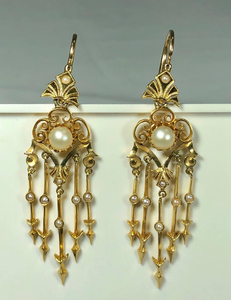 Antique Victorian 18 karat natural pearl and seed pearl chandelier earrings. These stunning Victorian true antique earrings are created in 18 karat (tests 18 Karat), yellow gold. The rich yellow orange bright gold has such a beautiful patina, the