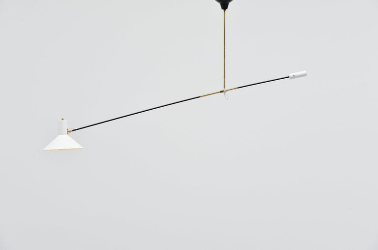 Rare early counter balance ceiling lamp model 5018 designed by JJM Hoogervorst and manufactured by Anvia Almelo, Holland, 1957. This counter balance lamp is usable in different positions as it is fully adjustable and can also be rotated. This