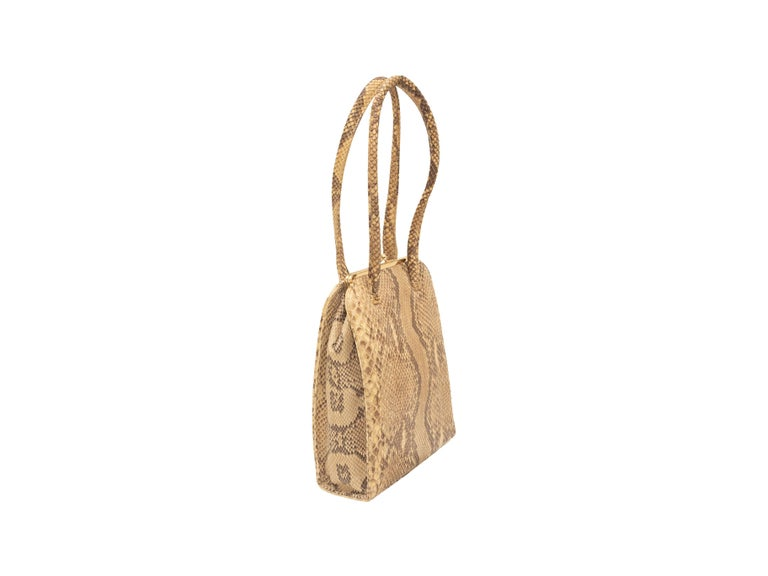 Product details: Vintage beige and black python handbag by Anya Hindmarch. Gold-tone hardware. Dual handle straps. Kiss-lock closure at top. 8