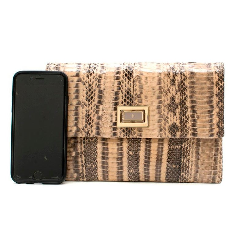 Anya Hindmarch Beige Python Valorie Clutch Bag.  - Snakeskin - Internal pouch pocket - Gold hardware - Lined in beige suede and nude leather - Designer-stamped twist lock fastening  Approx: 16cm x 23cm  ONESIZE