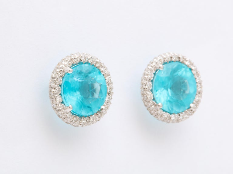Bright blue apatite are surrounded by micro pave set diamonds to create these unique stud earrings.  Easily wearable, bold and unique, these are destined to become someone's go to earrings for years to come. For pierced ears with extra large backs