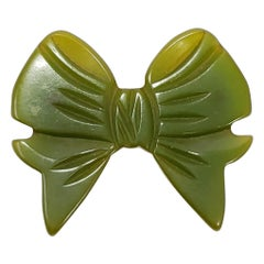 Apple Green Accented Bakelite Bow Pin Brooch, Early 1900s