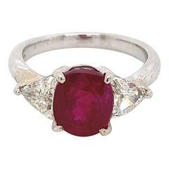 Apx 2.30 Carat Rudy with Trilliant Diamond Three Stone Ring 18 Karat White Gold