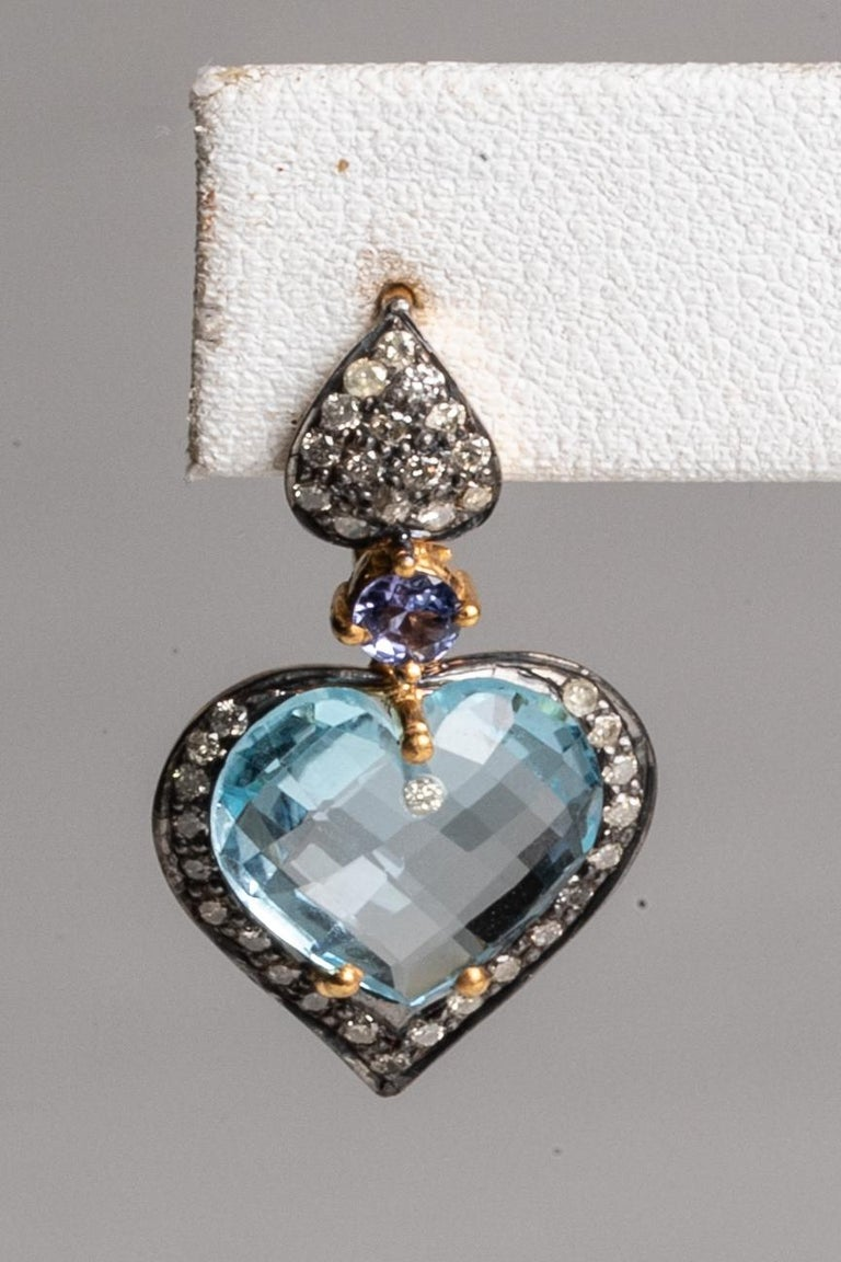 Lovely heart-shaped, faceted blue aquamarine bordered with round-cut pave`-set diamonds in sterling silver.  18K gold post for pierced ears.  All hand constructed.    See The Lockhart Collection storefront here on 1st Dibs to see the collection of