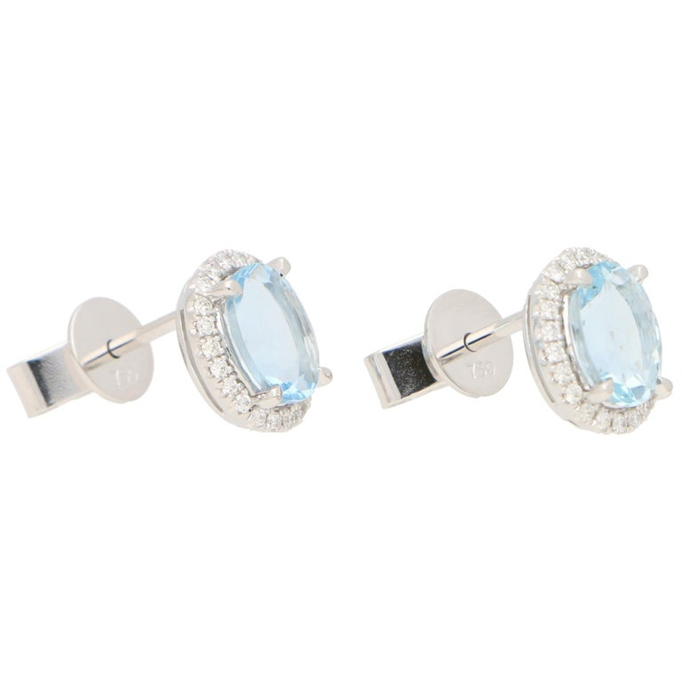 Modern Aquamarine and Diamond Halo Stud Earrings Set in 18k White Gold For Sale