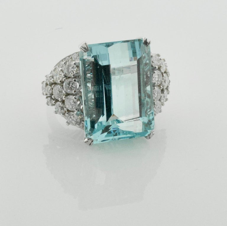 Aquamarine and Diamond Platinum Ring 20.00 carats  One Emerald Cut Cut Aquamarine weighing 20.00 carats [19.3 x 14.00 x 10.05] approximately [bright with no imperfections visible to the naked eye] Forty Five Round Brilliant Cut Diamonds weighing