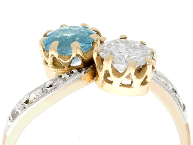 A fine and impressive antique 0.69 carat diamond and 0.62Ct aquamarine, 18 karat yellow gold and 18k white gold set twist ring; part of our diverse diamond jewelry and estate jewelry collections  This stunning, fine and impressive aquamarine and