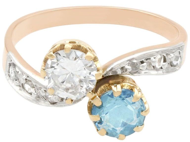 Round Cut Antique Aquamarine and Diamond Yellow Gold Twist Ring, Circa 1900 For Sale