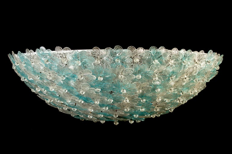 Amazing Mid-Century Modern hand blown Italian flush mount chandelier featuring overlapping crystal flowers, Aquamarine and ice, mounted on a webbed white painted frame.  Measures: Height 9.45 in. (24 cm). Diameter 23.62 in. (60 cm). 5 x E27 \