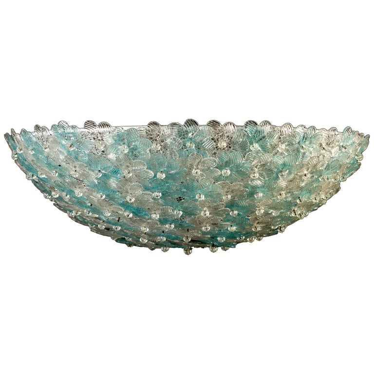 Amazing Mid-Century Modern hand blown Italian flush mount chandelier featuring overlapping crystal flowers, Aquamarine and ice, mounted on a webbed white painted frame.