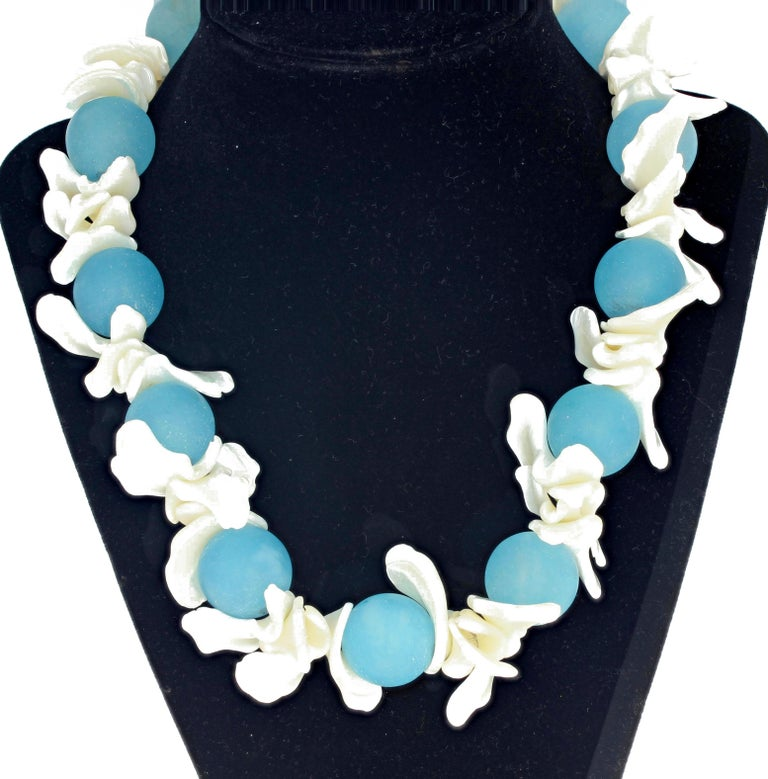 Approximately 15 mm round polished blue Aquamarine gem rocks set with dazzling curlly lacy white polished Pearl Shell with a sterling silver clasp.  This unique handmade necklace is 18.5 inches long.  More from this seller by putting gemjunky into