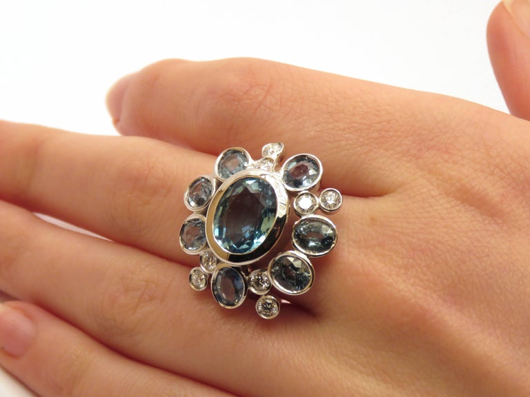 18 carat white gold floral ring with aquamarine, blue sapphires and diamonds, hancrafted in Italy by Botta Gioielli Aquamarine 4,86 ctw / 14x10 millimeters - 0,551181x0,393701 inches Seven blue sapphires 4,25 ctw Eight diamonds 0,60 ctw US size: 6,5