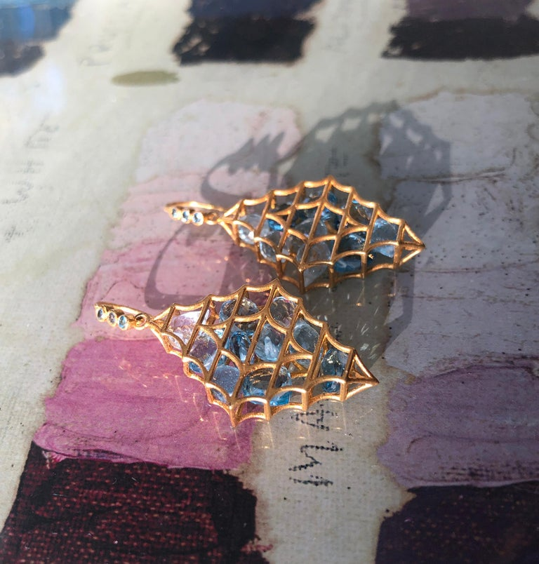 Aquamarine and London Blue Topaz faceted drops move inside these 18kt Gold cage Earrings by Lauren Harper.  Lightweight enough for all day wear, with a great wow factor!  Ships directly from original designer and creator, Lauren Harper, in beautiful
