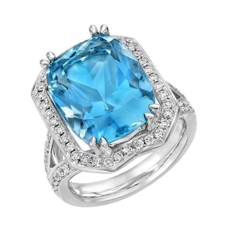 Marvelous 8.95 carat Aquamarine cushion, set in a 0.61 carat total diamond and 18K white gold ring. This unique Aquamarine combines a radiant cut and cushion shape outline, to maximize its brilliance. Ring size 6. Resizing is complementary upon