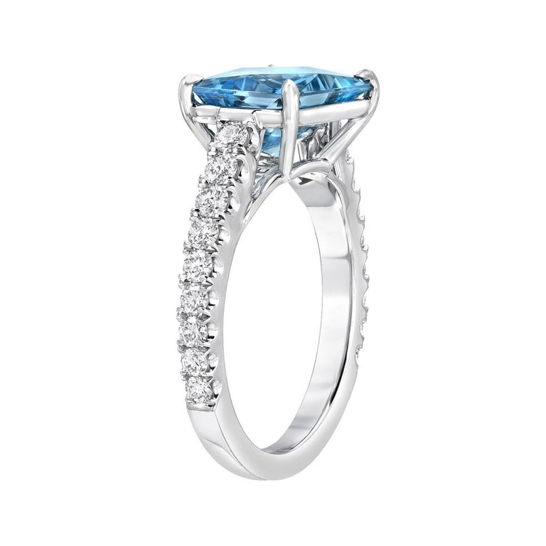 This custom emerald cut, natural Aquamarine weighing 2.59 carat, blends an emerald cut outline with a radiant cut, to maximize the brilliance of the gem. It is hand set horizontally in a striking 0.52 carat round brilliant diamond platinum ring for