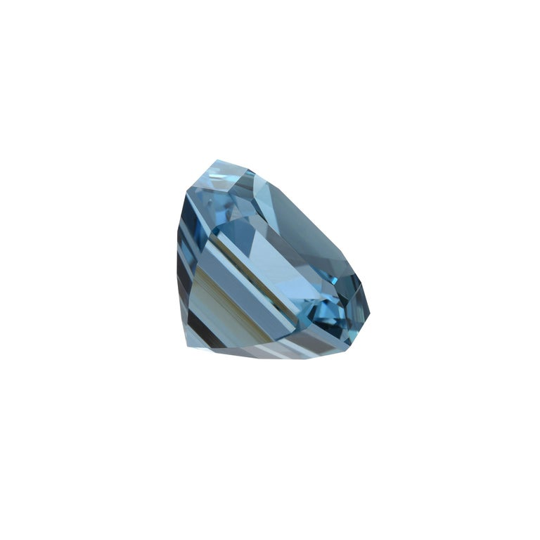 Ultra fine 14.34 carat Aquamarine emerald-cut , from India, exhibiting a very rare vivid blue color and superior clarity. This magnificent gem is a one of a kind classic item for a custom tailored cocktail ring. Extraordinary Aquamarines of this