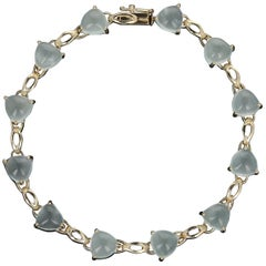 Aquamarine Link Bracelet, 14 Karat Yellow Gold Trillion Cabochons