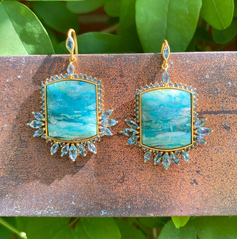 Designed by award winning jewelry designer, Lauren Harper, these fossilized opalized wood and aquamarine earrings are a one of a kind. Set in a warm 18kt Gold alloy, these hand made earrings embody ocean blues and are sure to get you noticed.